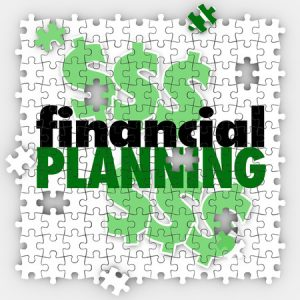 financial planning words on puzzle pieces to illustrate finishing or completing your budget or retirement savings goal or objective