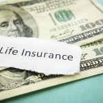 paper scrap with life insurance text on cash